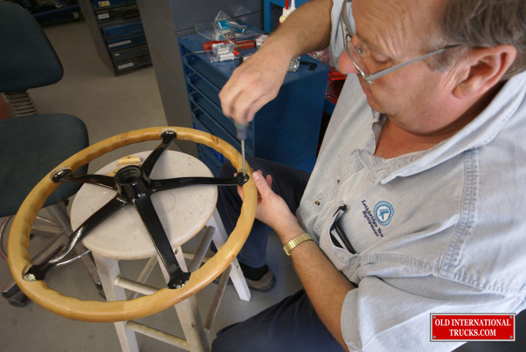 George putting the steering wheel together